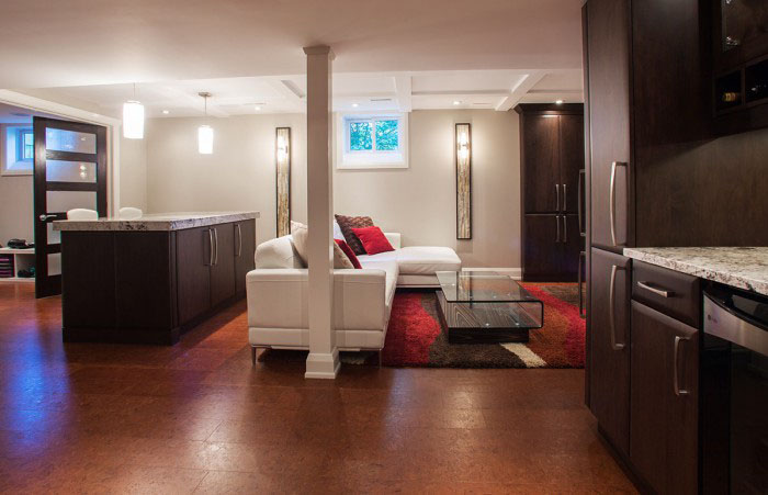 basement renovation with custom maple cabinetry